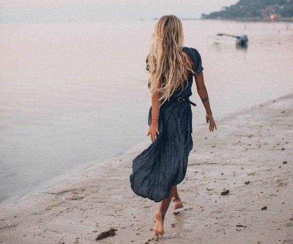 photo-of-woman-walking-on-seashore-2072583.jpg